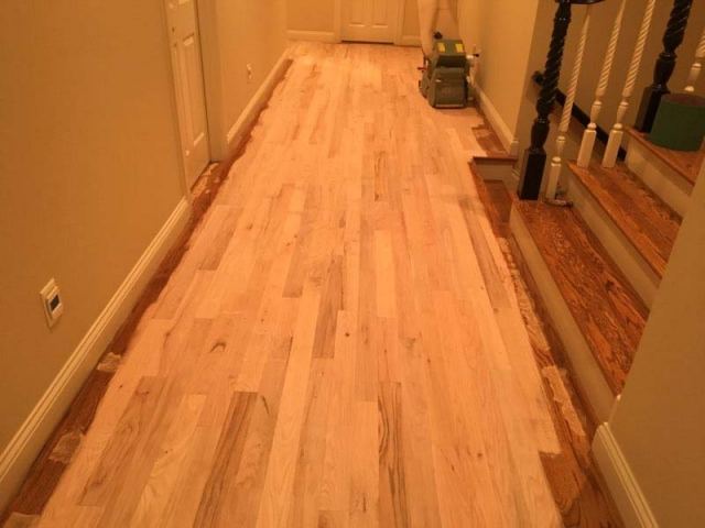 Sanding and preparing the existing floors for a refinish